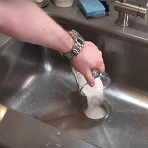 how to unclog kitchen sink with disposal